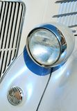 White Classic Car Headlight. The headlight of a white classic car Stock Image