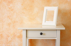 White classic frame against terracotta wall Stock Photos