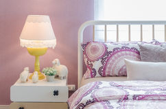 White classic lamp style with dolls on table side in kid's bedro Royalty Free Stock Photos