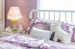 White classic lamp style with dolls on table side in kid's bedro Stock Image