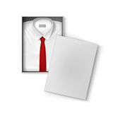 White classic men shirt with red tie in packaging box Royalty Free Stock Images