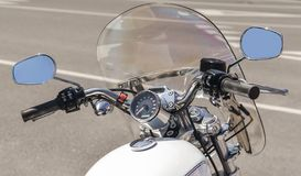 White classic motorcycle chopper on a city street close up stock photo