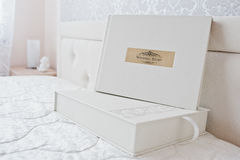 White classic photo album or photobook with golden frame with si Stock Images