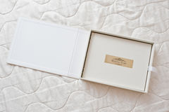 White classic photo album or photobook with golden frame with si Royalty Free Stock Image