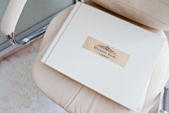 White classic photo album or photobook with golden frame with si Stock Photography