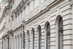 White, classical building architecture with windows and street l Royalty Free Stock Photos