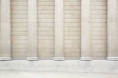 White classical columns and wall background. With stone floor Royalty Free Stock Images