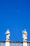 White classical statue and flying air in blue sky. Rome, Italy Stock Photography