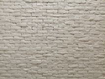 White clay brick wall facade interior design for pattern wallpaper, background and backdrop. Shop, commercial, texture, masonry, bricks, stone, natural royalty free stock image