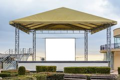 White clean billboard on a stage with copy space zone for logo, text or advertising caption. royalty free stock photo