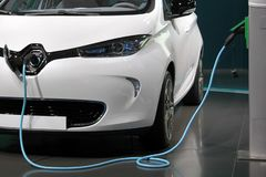 White and clean electric car charging in a garage.  stock photos