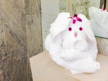White clean hand towel cute rabbit  with orchid flower Royalty Free Stock Image