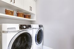 White clean laundry room modern with washer and dryer.  stock photo