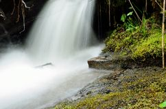 White clean waterfall in mossy green nature. In the arctic circle wilderness, long exposure shot Stock Image