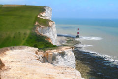 White cliffs. A lovely coastal scene at Beachy Head which is near Eastbourne UK showing a lighthouse Stock Photo