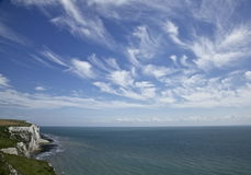 White cliffs of Dover, sea and clouds. Stock Photos