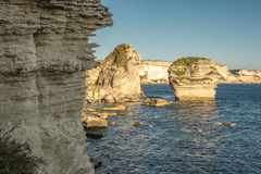 White cliffs, stacks and Mediterranean at Bonifacio in Corsica Royalty Free Stock Images