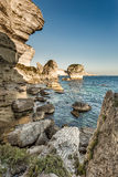 White cliffs, stacks and Mediterranean at Bonifacio in Corsica Stock Images