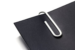 White Clip with Black Paper Stock Photo