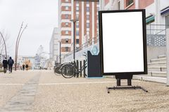White clipped billboard in a pedestrian zone royalty free stock photo
