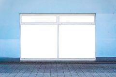 White clipped windows on a blue wall in the street. The clipped area replaces an existing advertisement. Commercial and advertisin. G concept Royalty Free Stock Photo