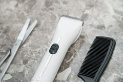 White clipper with attachment in hairdressing salons closeup. White clipper with attachment in a bathroom closeup stock image