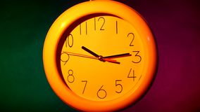 White clock on colorful background. White office clock on colorful background. with clipping path stock video