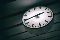 White clock is hanging down Stock Photography