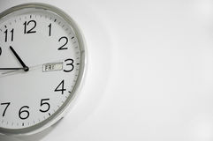 White clock hanging at the wall Stock Photography