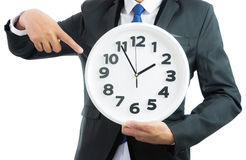 White clock holding in businessman hands isolated Stock Image
