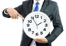 White clock holding in businessman hands isolated Royalty Free Stock Image