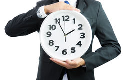 White clock holding in businessman hands isolated Stock Images