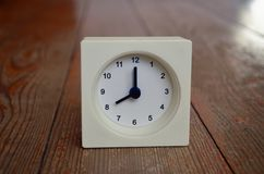 A white clock indicating the eight hour Royalty Free Stock Images