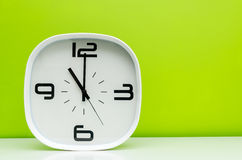 White clock on light green background Royalty Free Stock Photos