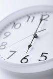 White clock showing six o'clock Stock Photo