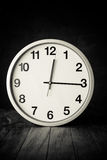 White clock on a table Stock Images