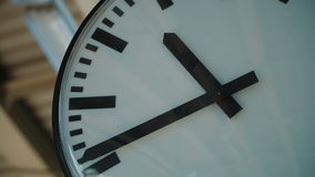 White clock ticking at the train station. Close up. Full Hd Stock Footage stock video footage