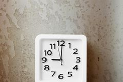 White Clock . Time Nine Alarm Clock on Old Brown Crack Wall Background. Great For Any Use Royalty Free Stock Photography