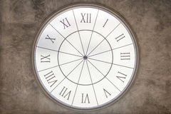 White  Clock time on old grungy grey concrete wall. Royalty Free Stock Image