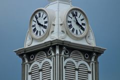 White clock tower with blue sky stock photo