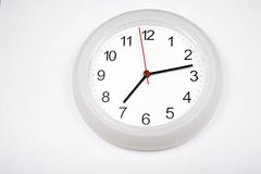 White clock with white background Royalty Free Stock Image