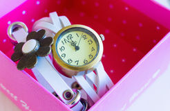 White clock. Womens White Watch In A Pink Box Royalty Free Stock Photo