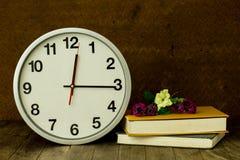 White clock on wooden table Stock Photos