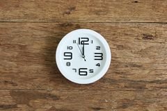 White clock on wooden wall. Top view Royalty Free Stock Image