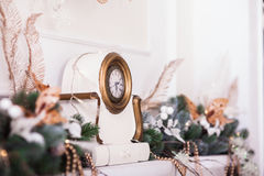 White clocks with decorated branches of Christmas tree. Royalty Free Stock Photo
