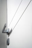 White closed door. Detail of white wooden door cloded royalty free stock photo