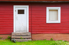 White closed door and window in red wall Royalty Free Stock Photography