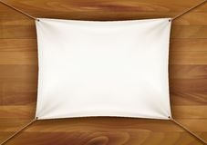 White cloth banner with text space on wooden background. Stock Image