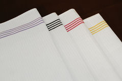 White cloth napkins. White kitchen white cloth napkins with stripes Royalty Free Stock Image