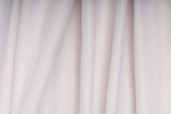 White cloth with pink shade in the folds Royalty Free Stock Photo